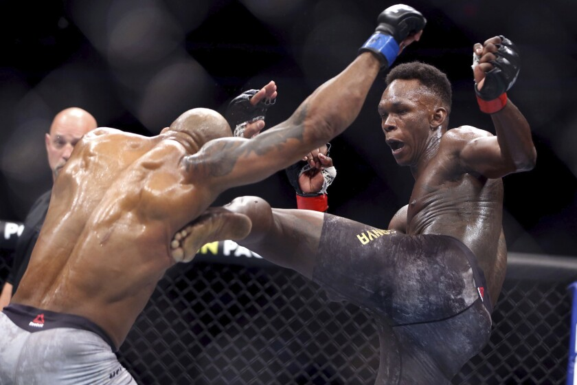 FILE - In this March 7, 2020, file photo, UFC middleweight champion Israel Adesanya of Nigeria.