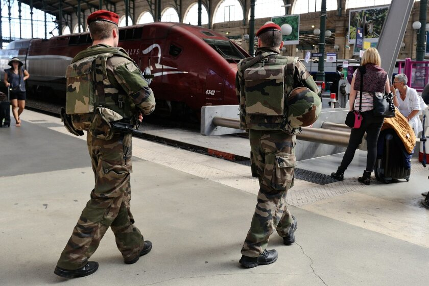 FILE - In this Aug .22 2015 file photo, French soldiers patrol at Gare du Nord train station in Paris, France. The attack Aug. 21 on the Thalys train from Amsterdam to Paris happened at the height of the summer travel season. France hosts emergency talks in Paris on Saturday, with representatives from other high-speed international rail nations, Belgium, Britain, Germany, Italy, Luxembourg, the Netherlands, Spain and Switzerland. (AP Photo/Binta, File)