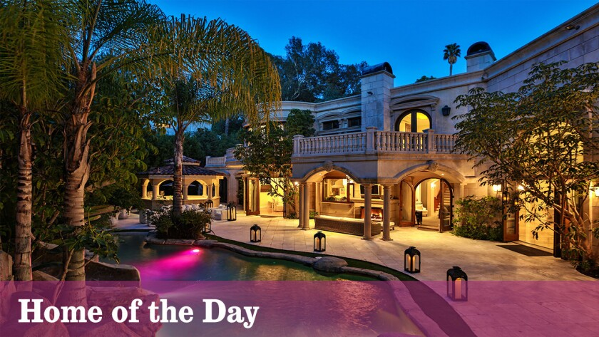 Designed for entertaining, this contemporary Mediterranean estate provides an impressive welcome complete with filigree wrought-iron doors, exterior fountain and sweeping staircase.
