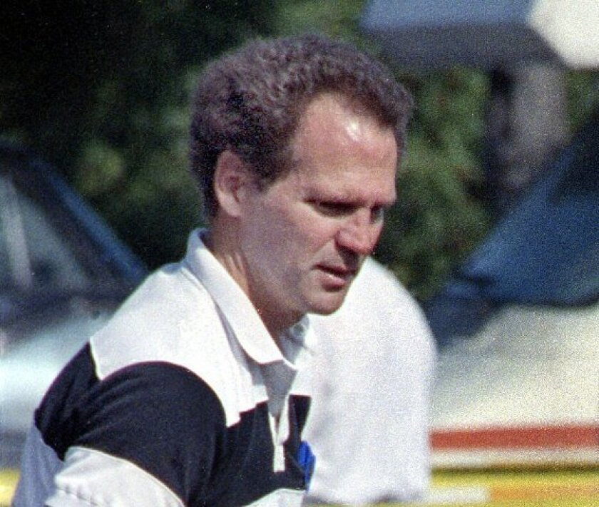 SDPD criminalist Kevin Brown works at a crime scene in 1991.