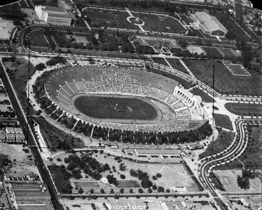 Sept. 20, 1927: An aerial photo shows the Los Angeles Memorial Coliseum filling up with spectators to welcome aviator Charles Lindbergh.
