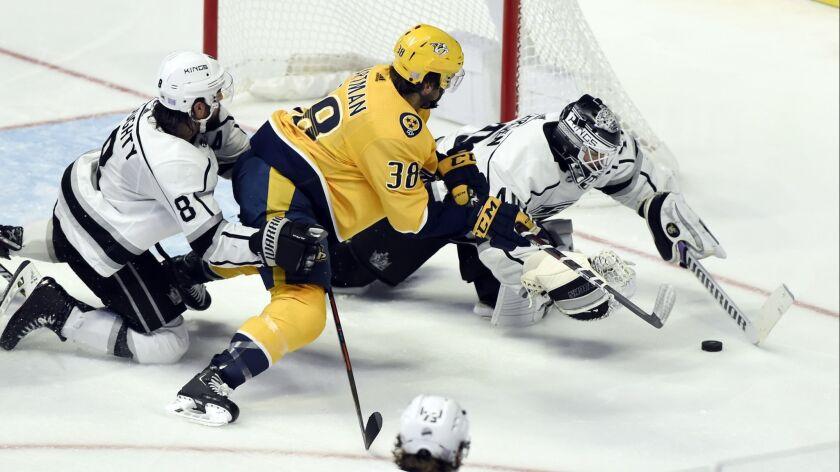 Los Angeles Kings goaltender Calvin Petersen (40) reaches for the puck as Nashville Predators right