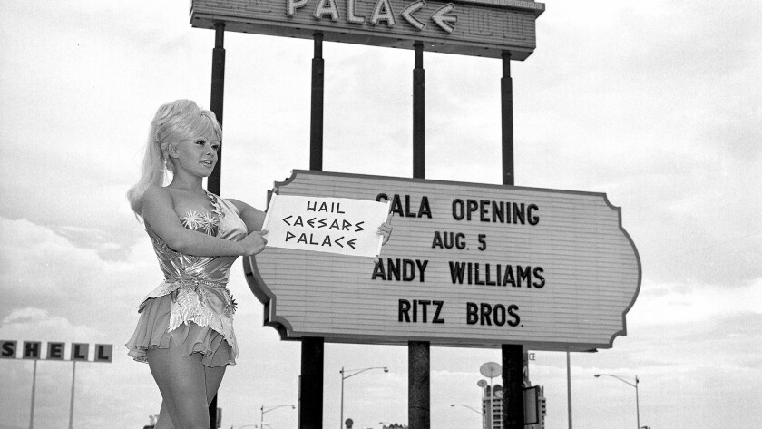 An employee of the new hotel-casino poses by the marquee on July 22, 1966, two weeks before the grand opening.