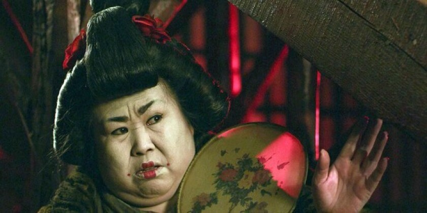 """Dong Lifan as the Keeper of the House of a Thousand Flowers in the movie """"The Butcher, the Chef and the Swordsman."""""""