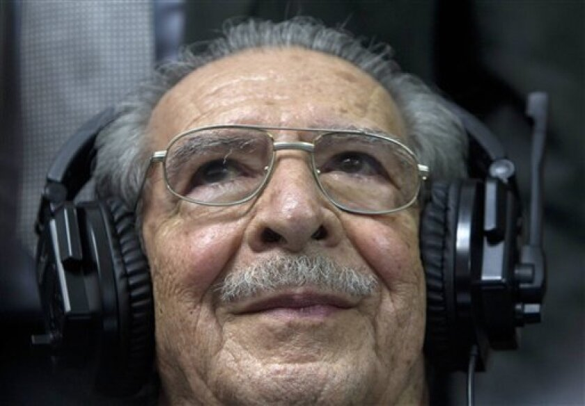 Guatemala's former dictator Jose Efrain Rios Montt sits in the courtroom before the judge reads the verdict during his genocide trial in Guatemala City, Friday, May 10, 2013. The Guatemalan court convicted Rios Montt on charges of genocide and crimes against humanity, sentencing him to 80 years in prison. The 86-year-old former general is the first former Latin American leader ever found guilty of such a charge. The war between the government and leftist rebels cost more than 200,000 lives and e