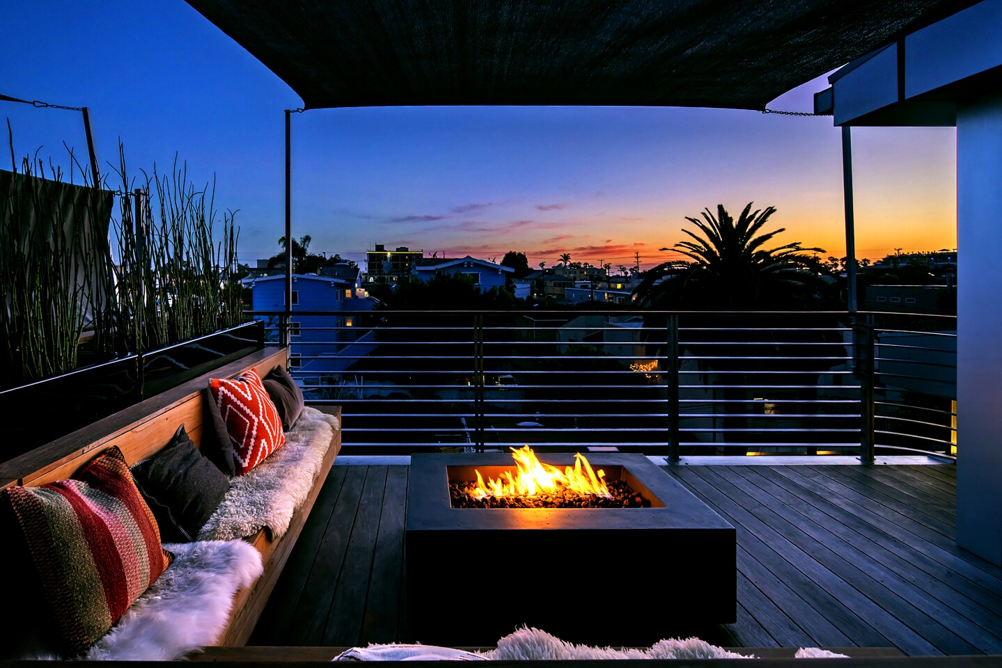 The panoramic rooftop has built-in seating, a natural gas fire pit and integrated kitchen equipped with a grill and prep sink.