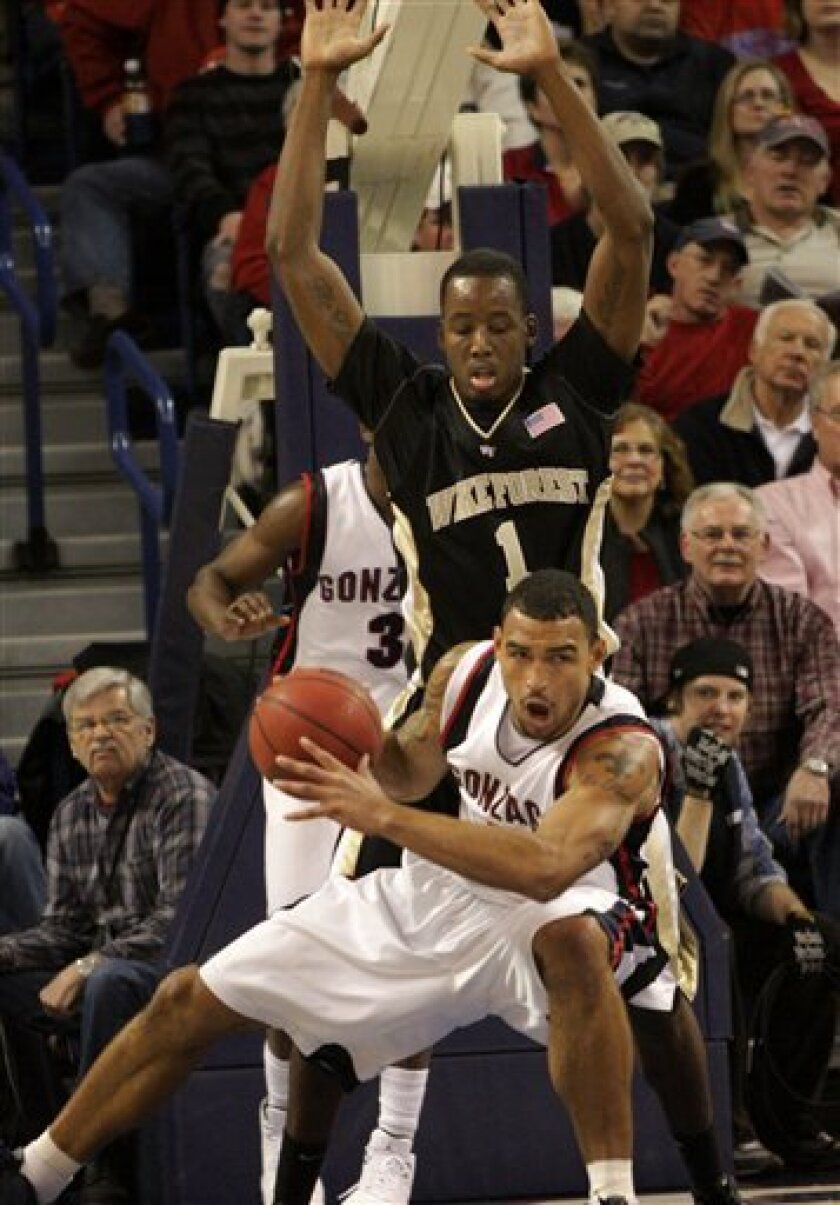 Gonzaga's Robert Sacre, foreground, tries to drive against Wake Forest's Al-Farouq Aminu in the first half of an NCAA college basketball game at McCarthey Athletic Center in Spokane, Wash., Saturday, Dec. 5, 2009. (AP Photo/Rajah Bose)
