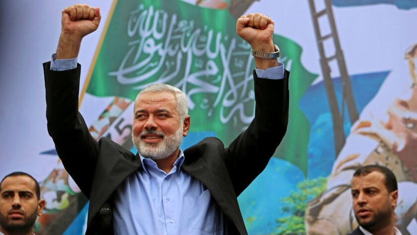 FILE - In this Friday, Dec. 12, 2014 file photo, Palestinian top Hamas leader Ismail Haniyeh greets