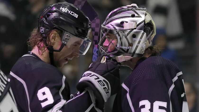 Los Angeles Kings goaltender Jack Campbell, right, celebrates with center Adrian Kempe, of Sweden, a