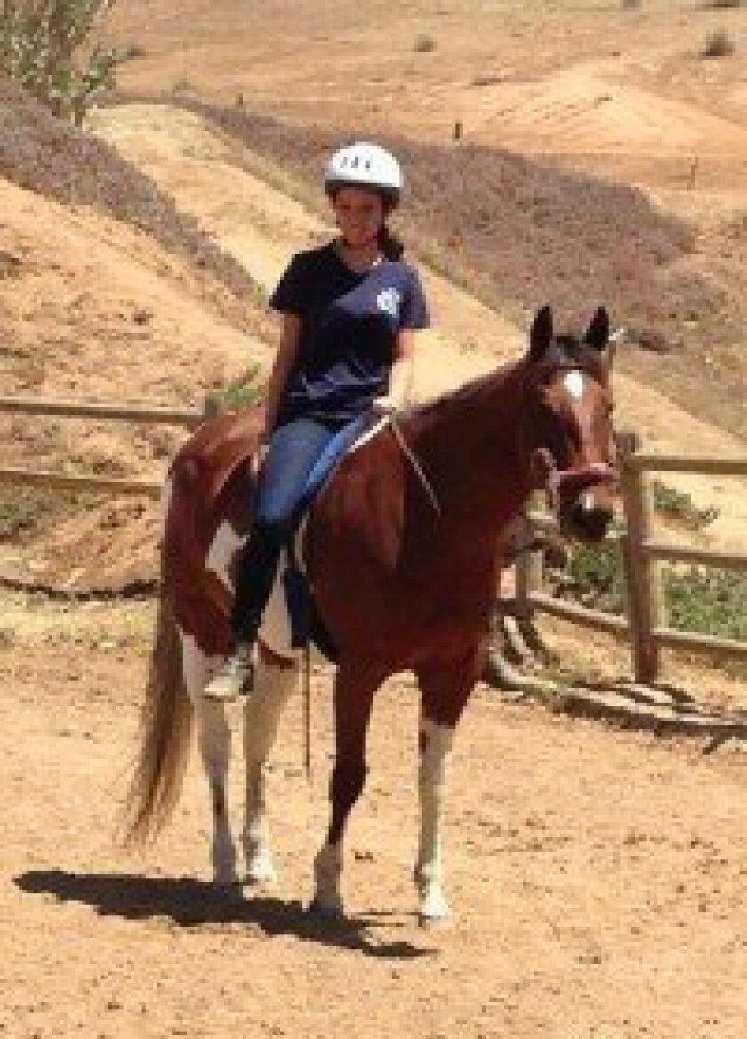 Ashlyn Mossy tries her hand at horsemanship. Courtesy photo