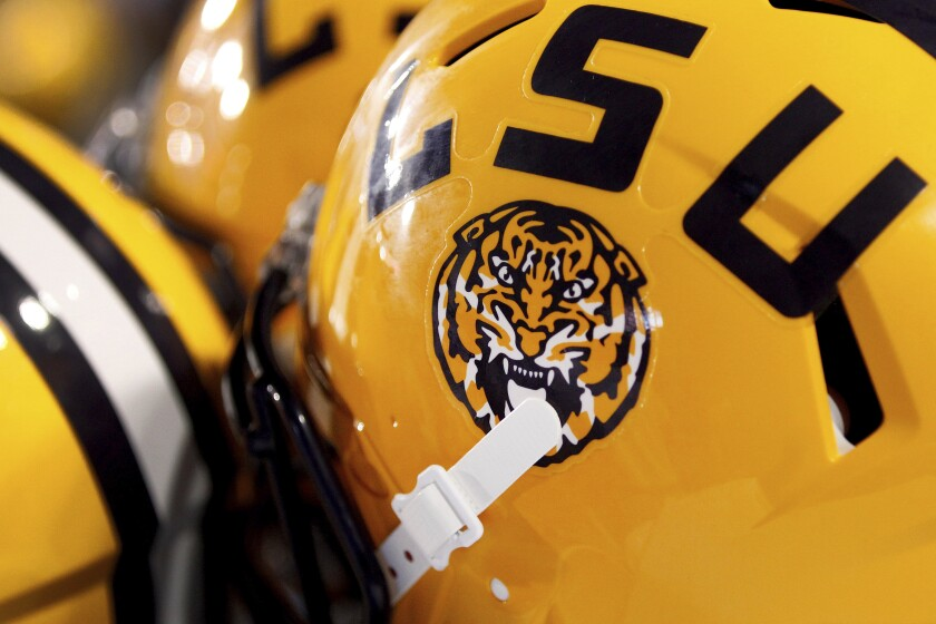 FILE - This Saturday, Sept. 6, 2014 file photo shows the LSU logo on a helmet in Baton Rouge, La. A federal lawsuit says Louisiana State University did too little to address allegations of sexual harassment and assault against a French graduate student, even after learning he had been arrested on a rape charge in central Louisiana. (AP Photo/Jonathan Bachman, File)