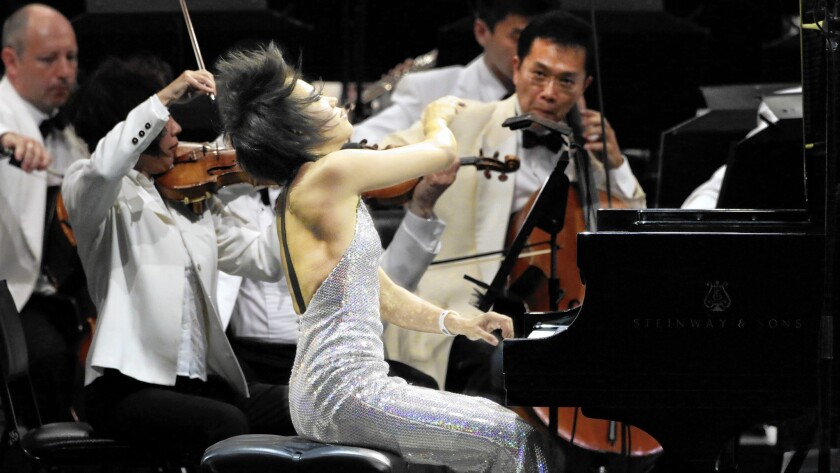 Yuja Wang returns to the Hollywood Bowl with conductor Lionel Bringuier in flamboyant form both in fashion and, more to the point, in performance.