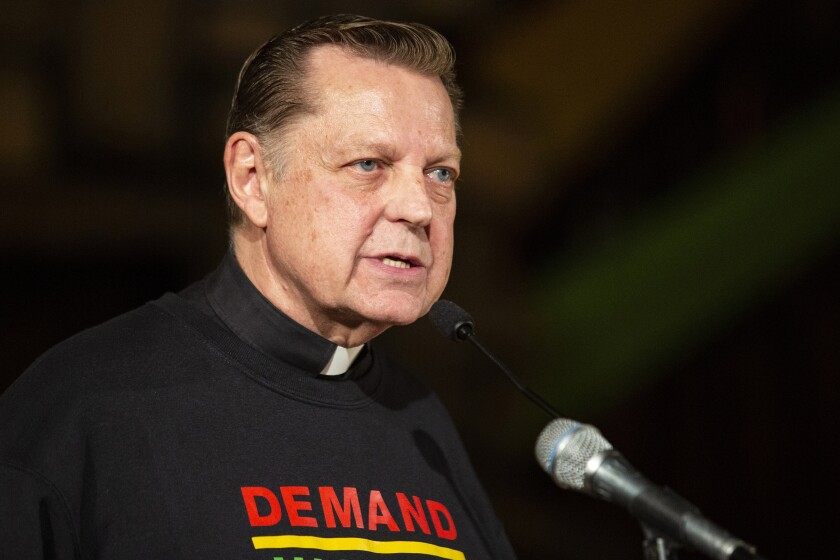 FILE - In this May 9, 2019, file photo, Father Michael Pfleger speaks at Saint Sabina Catholic Church, in Chicago. In a letter written to the Saint Sabina community, Chicago Cardinal Blasé Cupich announced Tuesday, Jan. 5, 2021, he has asked Pfleger to step aside from his ministry following receipt of a sexual abuse allegation of a minor by Pfleger more than 40 years earlier. (Ashlee Rezin/Chicago Sun-Times via AP)