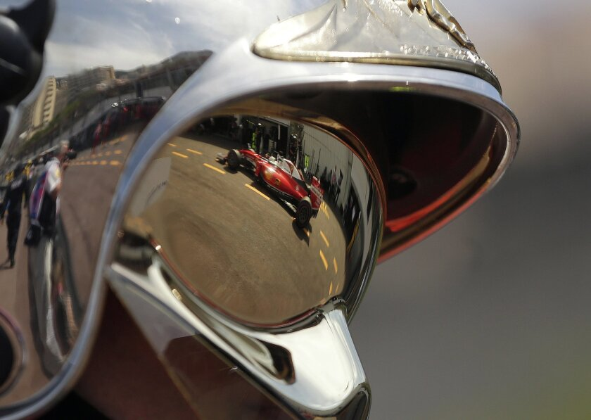The car of Ferrari driver Sebastian Vettel of Germany is reflected in the goggles of a  team mechanic during the second free practice at the Monaco racetrack in Monaco, Monaco, Thursday, May 26, 2016. The Formula one race will be held on Sunday. (AP Photo/Petr David Josek)