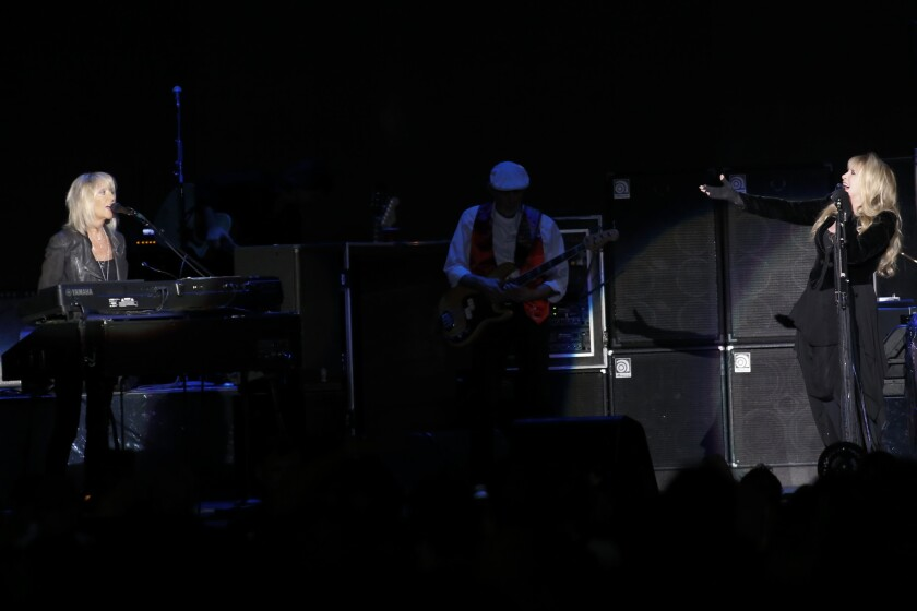 Christine McVie, left, and Stevie Nicks perform during Fleetwood Mac's concert Saturday night at the Forum in Inglewood.