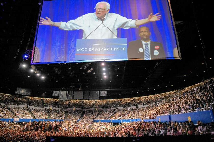 Presidential candidate Bernie Sanders speaks to a sold-out crowd at the Los Angeles Memorial Sports Arena on Monday night.