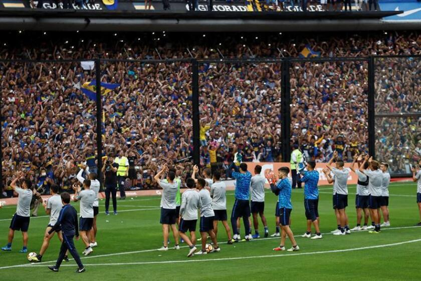Boca Juniors players cheer their fans during a farewell training session at La Bombonera Stadium in Buenos Aires, Argentina, on Nov. 22, 2018. Boca Juniors will face River Plate in the second leg of the 2018 Copa Libertadores final on Nov. 24. EPA-EFE/JUAN IGNACIO RONCORONI