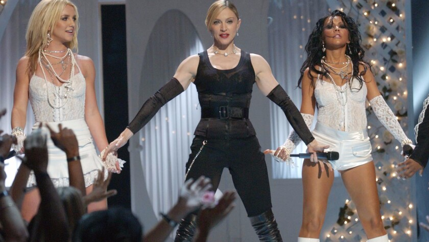 Britney Spears, from left, Madonna and Christina Aguilera at the 2003 MTV VMAs. This year, Spears will perform on the telecast for the first time since 2007.