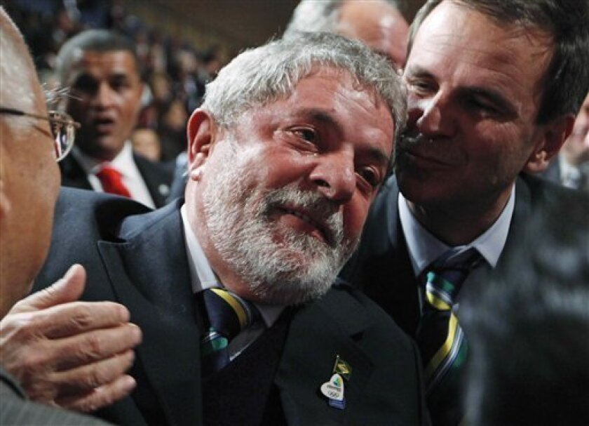 Brazil's President Luiz Inacio Lula da Silva reacts after it was announced that Rio de Janeiro has won the bid to host the 2016 Summer Olympic Games at the 121st International Olympic Committee session at the Bella Center in Copenhagen, Friday, Oct. 2, 2009. Chicago, Madrid, Rio de Janeiro and Tokyo competed for the right to host the 2016 Summer Olympic Games. (AP Photo/Charles Dharapak, Pool)