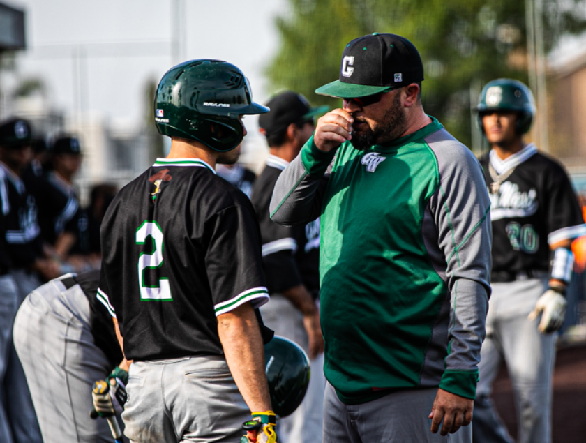 Andrew Ramos, right, becomes just the third head baseball coach in Golden West College history.