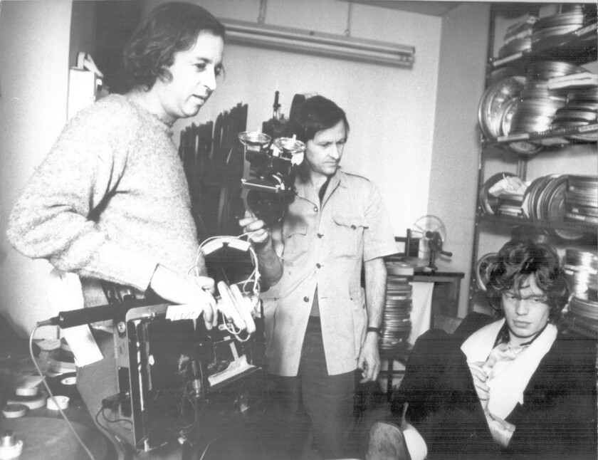 """Filmmakers Albert, left, and David Maysles, with Mick Jagger on the set of their documentary """"Gimme Shelter"""" in 1970."""