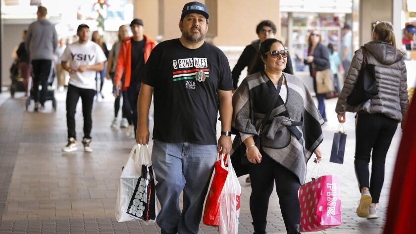 The holiday shopping frenzy continues after Christmas with people redeeming gift cards and exchanging items.