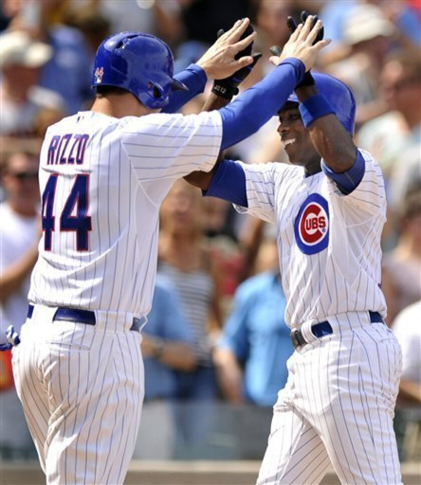 Chicago Cubs' Alfonso Soriano, right, celebrates with teammate Anthony Rizzo left, after hitting a two-RBI home run in the third inning during a baseball game against the San Francisco Giants in Chicago, Friday, Aug. 31, 2012. (AP Photo/Paul Beaty)