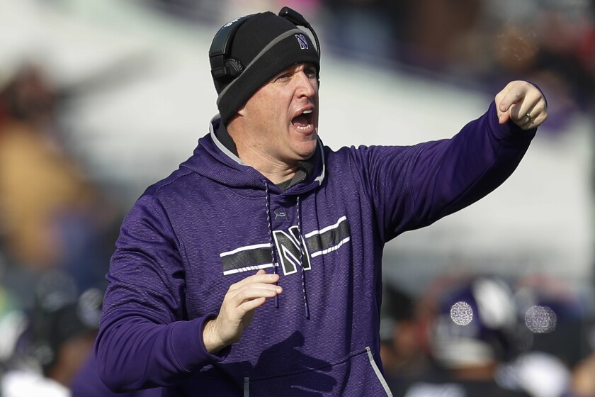 FILE - In this Saturday, Nov. 16, 2019, file photo, Northwestern coach Pat Fitzgerald calls out a play during the first half of an NCAA college football game against Massachusetts, in Evanston, Ill. Northwestern underwent quite a transformation last season, and it sure wasn't the kind the Wildcats welcomed. They became the first team to go from playing in the Big Ten championship game to finishing last in the division the following year. They're looking for a quick turnaround. (AP Photo/Jim Young, File)