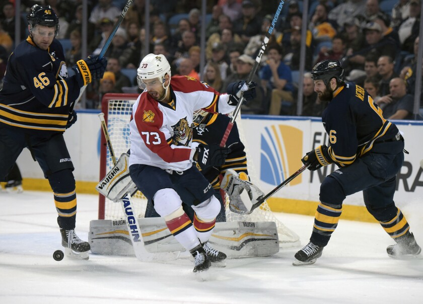 Florida's Brandon Pirri battles for a loose puck as Buffalo's Cody Franson, left, and Mike Weber defend on Feb. 9.