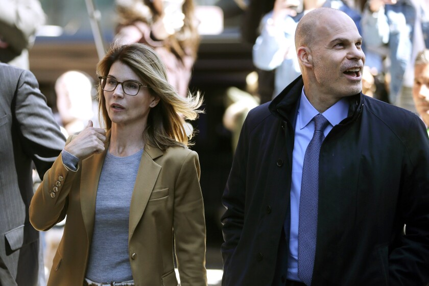 In this April 3, 2019, photo, Lori Loughlin, left, arrives at federal court in Boston with her attorney Sean Berkowitz to face charges in a nationwide college admissions bribery scandal. Berkowitz, a former federal prosecutor, has a reputation for being fearless, yet cool-headed and a master at navigating complex cases. (AP Photo/Steven Senne)