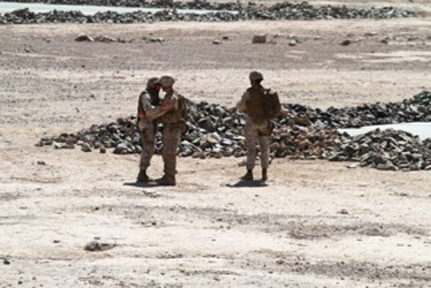 """Now Zad District, Helmund Province Afghanistan: Maj. Gen. Spiese says farewell to son, """"MG"""", 2010. Photo courtesy Maj. Gen. Spiese."""