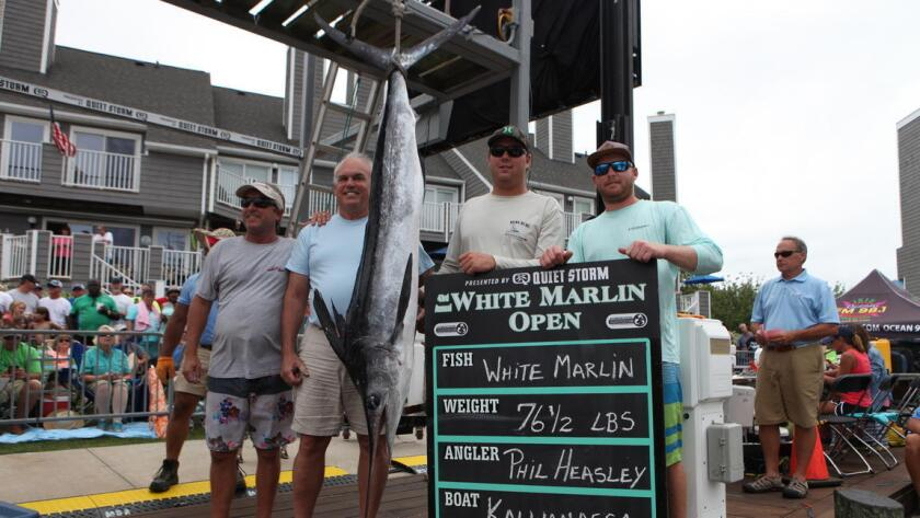 Philip G. Heasley, second from the left, poses with the crew of the Kallianassa. Heasley caught the winning 76.5-pound white marlin, but later failed two polygraph tests, according to court filings.