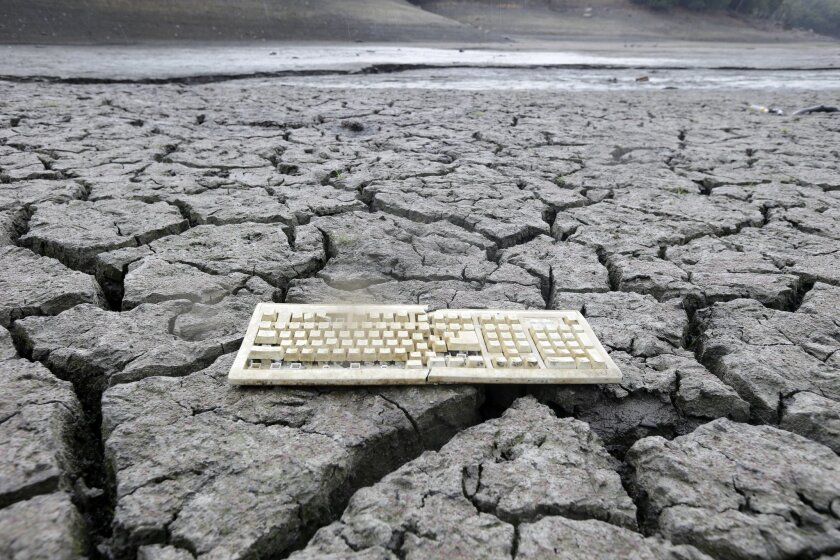 A discarded computer keyboard lies on the dry, cracked bed of the Almaden Reservoir in San Jose on Friday, Feb. 7, 2014 during the state's worst drought in recorded history.