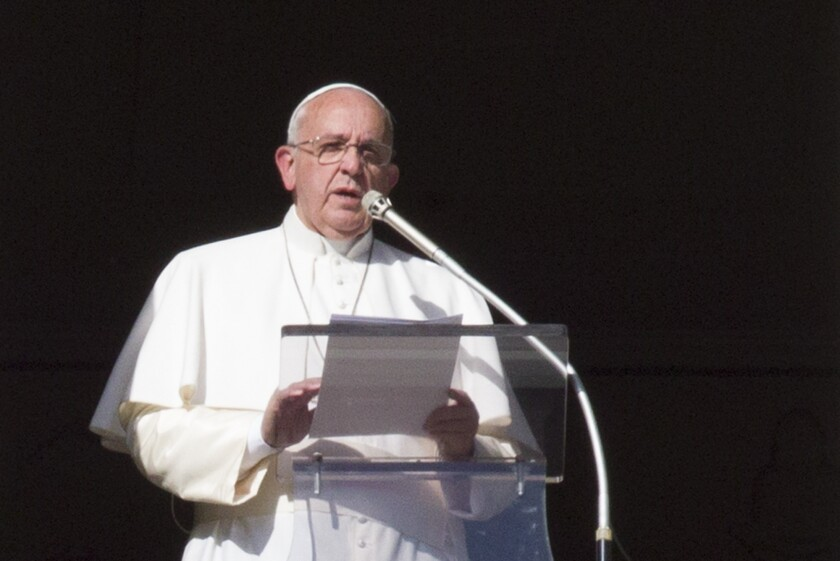 Pope Francis speaks during the Angelus noon prayer from his studio window overlooking St. Peter's square at the Vatican.
