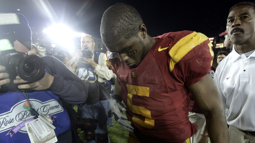 Reggie Bush leaves the field after the Trojans lost to the Texas Longhorns for the national champion