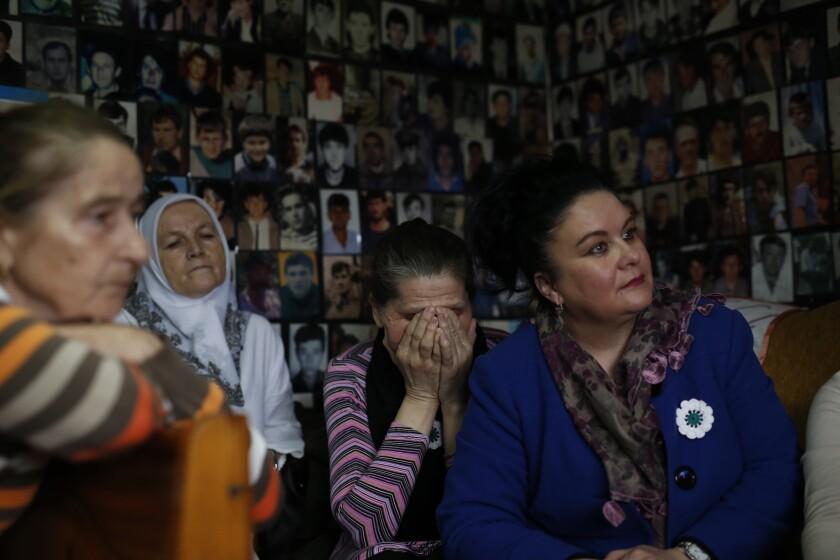 Women who lost family members in Srebrenica react as they watch a broadcast of the sentencing of Radovan Karadzic in Tuzla, Bosnia on March 24.