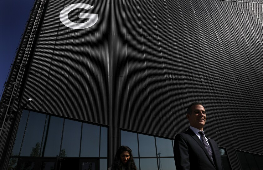 Mayor Eric Garcetti, right, visits Google's offices at the Spruce Goose hangar in Playa Vista in 2018.
