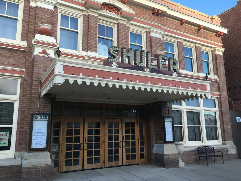 This Sunday, May 22, 2016 photo shows the newly refurbished Shuler Theater in downtown Raton, N.M. The theater is one of many theaters in rural New Mexico towns being revitalized thanks to a state initiative. A New Mexico economic development program, similar to efforts in Iowa and Illinois, seeks to save the often-forgotten theaters in small cities and towns with help on refurbishing buildings and grants for new digital projection and sound equipment. (AP Photo/Russell Contreras)