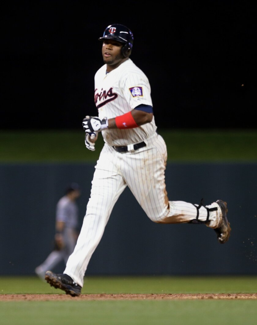 Minnesota Twins' Kennys Vargas rounds the bases on a two-run home run off Chicago White Sox pitcher Scott Snodgress in the sixth inning of a baseball game, Wednesday, Sept. 3, 2014, in Minneapolis. (AP Photo/Jim Mone)