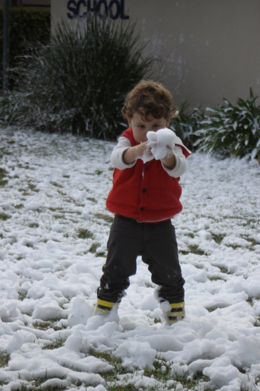 Elliot Sims is fascinated by the snow.