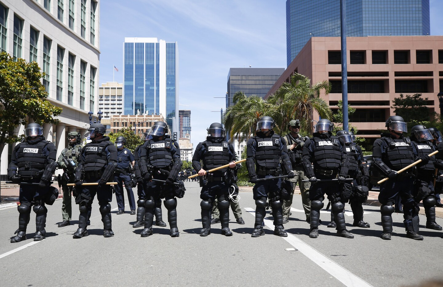 San Diego police in riot gear lined Broadway in downtown San Diego stopping a group of protesters on May 31, 2020. The group was protesting the death of George Floyd.