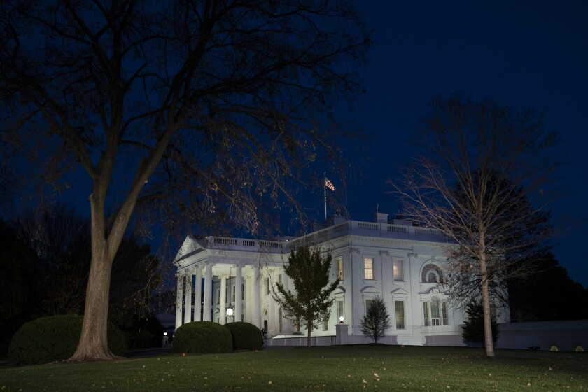 An exterior view of the White House at night
