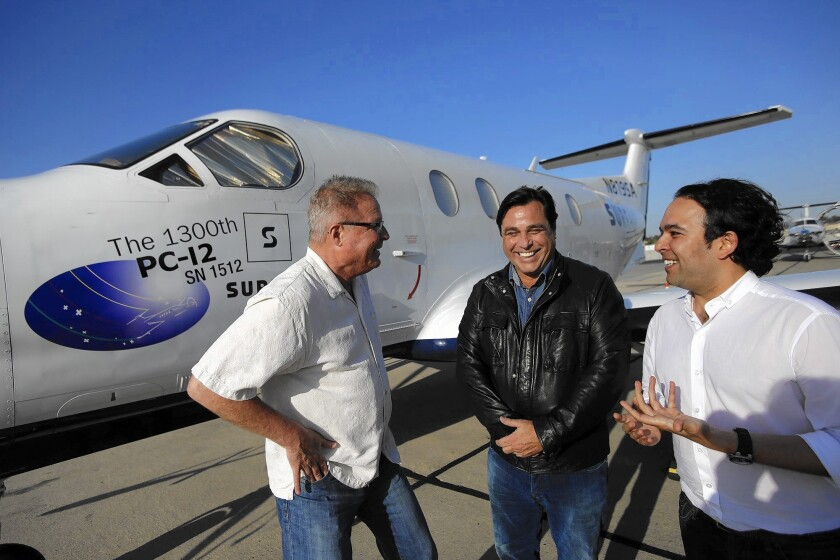 Surf Air CEO Jeff Potter, investor William Woodward and Executive Chairman Sudhin Shahani next to one of the members-only airline's aircraft at Hawthorne Municipal Airport last month.