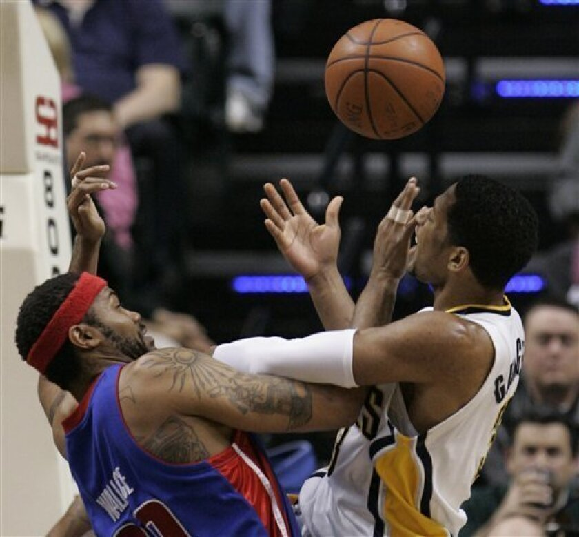 Detroit Pistons center Rasheed Wallace, left, and Indiana Pacers forward Danny Granger get tangled as they go for a loose ball during the first quarter of an NBA basketball game in Indianapolis, Wednesday, Jan. 14, 2009. (AP Photo/Darron Cummings)