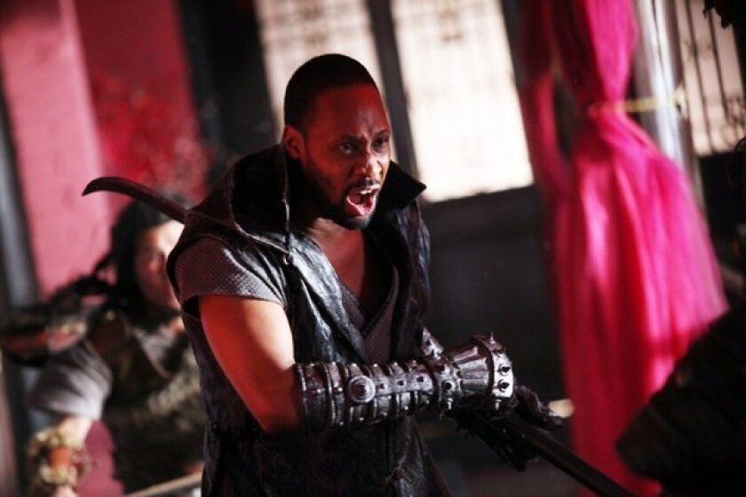 """Rapper turned actor-director RZA in a scene from """"The Man With the Iron Fists."""""""