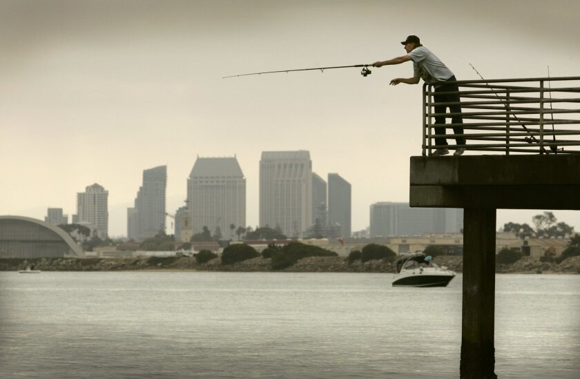 Harley Keech of El Cajon casts a fishing line into San Diego Bay from the Shelter Island Pier. A state health advisory urges anglers to limit consumption of certain fish from the bay. U-T file photo.