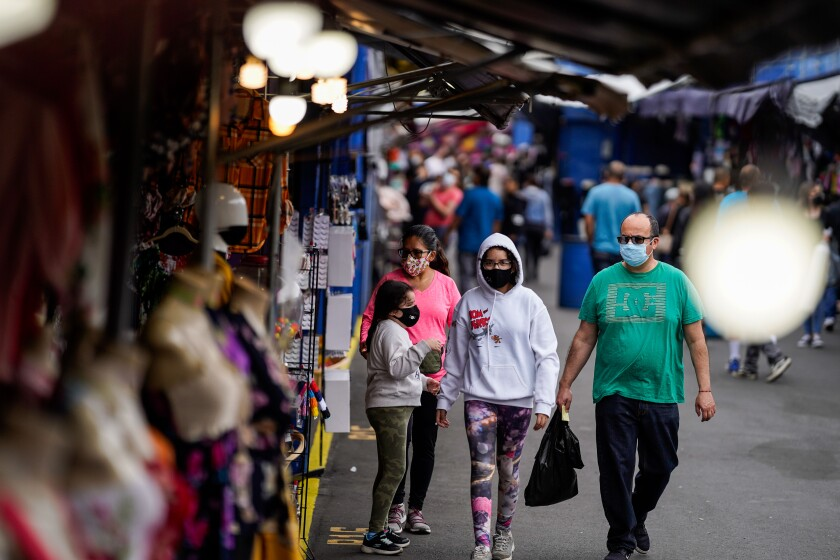 Shoppers wear masks at the Santa Fe Springs Swap Meet