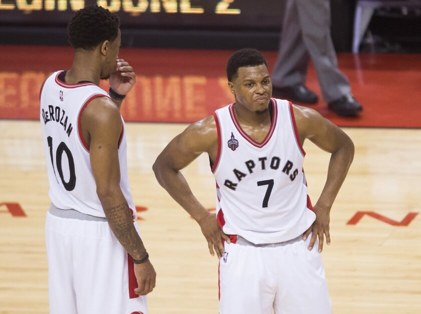 Toronto Raptors guard Kyle Lowry (7) stands next to teammate DeMar DeRozan (10) during the second half of Game 6 of the NBA basketball Eastern Conference finals, Friday, May 27, 2016, in Toronto. The Cleveland Cavaliers won 113-87 and advanced to the NBA Finals. (Nathan Denette/The Canadian Press v