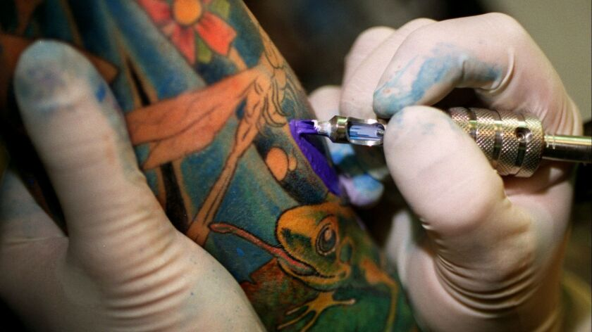 ME.Tattoo.detail.0822.DF – Shop owner Gerard Collette tattoos Paula Bishop of Huntington Beach Frida