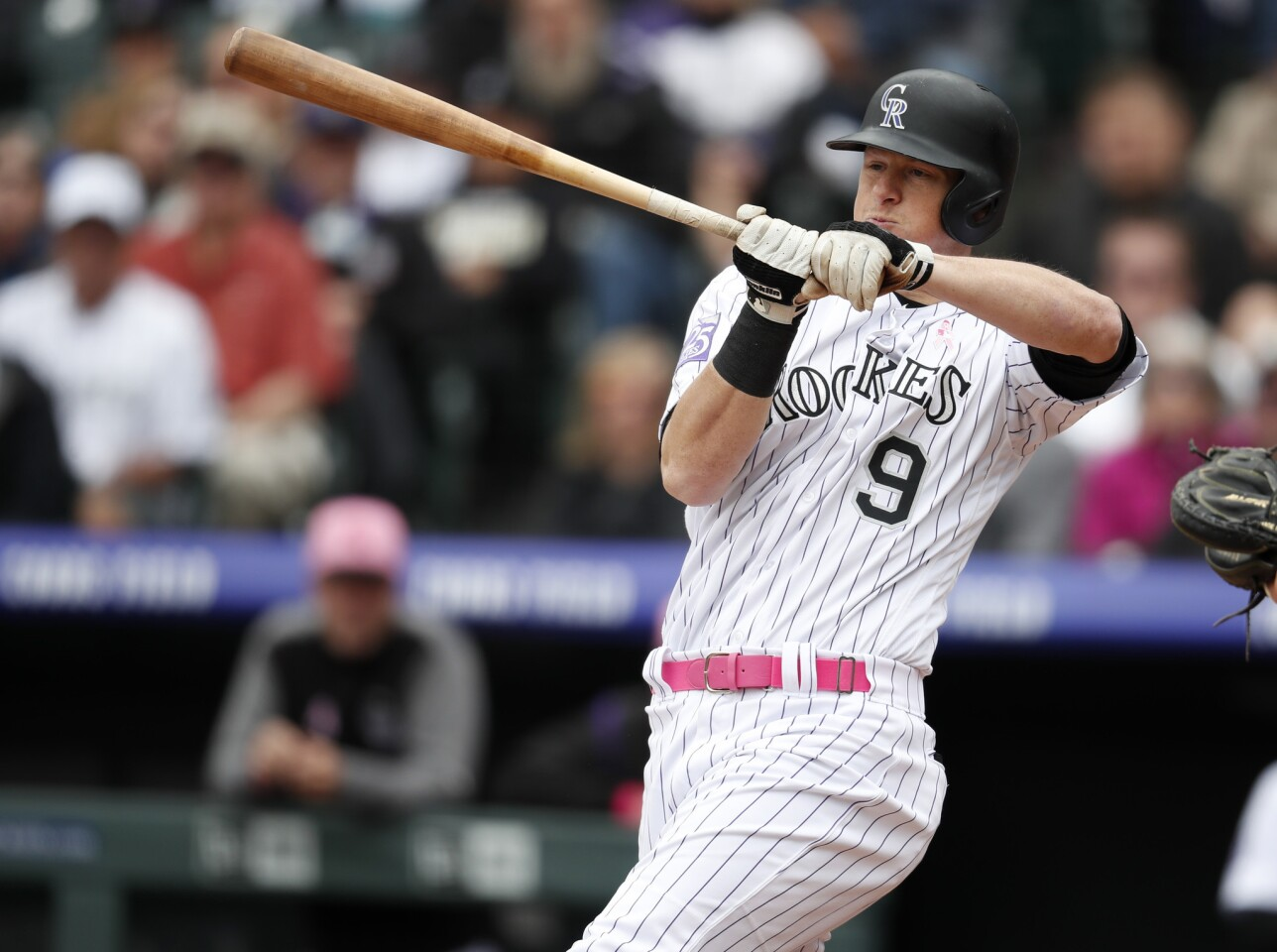 Colorado Rockies' DJ LeMahieu strikes out while trying to check his swing on a pitch from Milwaukee Brewers starting pitcher Freddy Peralta in the third inning of a baseball game Sunday, May 13, 2018, in Denver. (AP Photo/David Zalubowski)
